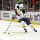 Buffalo Sabres defenseman Andrej Meszaros (41) of the Czech Republic takes the puck towards the Detroit Red Wings net in the first period of an NHL hockey game at Joe Louis Arena in Detroit, Sunday, Jan. 18, 2015 The Associated Press
