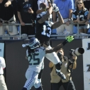 Carolina Panthers wide receiver Kelvin Benjamin (13) misses a catch in the end zone against Seattle Seahawks cornerback Richard Sherman (25) during the first half of an NFL football game, Sunday, Oct. 26, 2014, in Charlotte The Associated Press