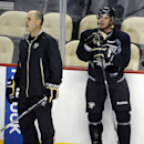 Pittsburgh Penguins' Sidney Crosby, right, stands with new assistant coach Rick Tocchet during the first day of NHL hockey training camp, Friday, Sept. 19, 2014, in Pittsburgh The Associated Press
