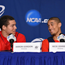 Arizona guard Nick Johnson, right, smiles at forward Aaron Gordon as they answer questions at the NCAA college basketball tournament, Wednesday, March 26, 2014, in Anaheim, Calif. Arizona is scheduled to play San Diego State on Thursday in a regional semifinal. (AP Photo/Mark J. Terrill)