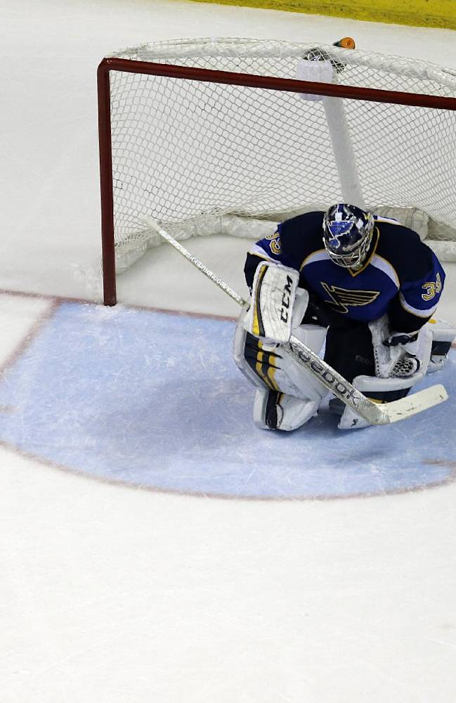 St. Louis Blues goalie Ryan Miller pauses after giving up the game-winning goal to Chicago Blackhawks' Jonathan Toews during overtime in Game 5 of a first-round NHL hockey playoff series Friday, April 25, 2014, in St. Louis. The Blackhawks won 3-2