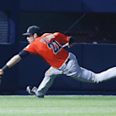 Miami Marlins left fielder Christian Yelich (21) can't reach a ball hit for double by Atlanta Braves pinch hitter Jordan Schafer in the ninth inning of a baseball game Monday, April 21, 2014 in Atlanta. Atlanta won 4-2 in the tens innings The Associated