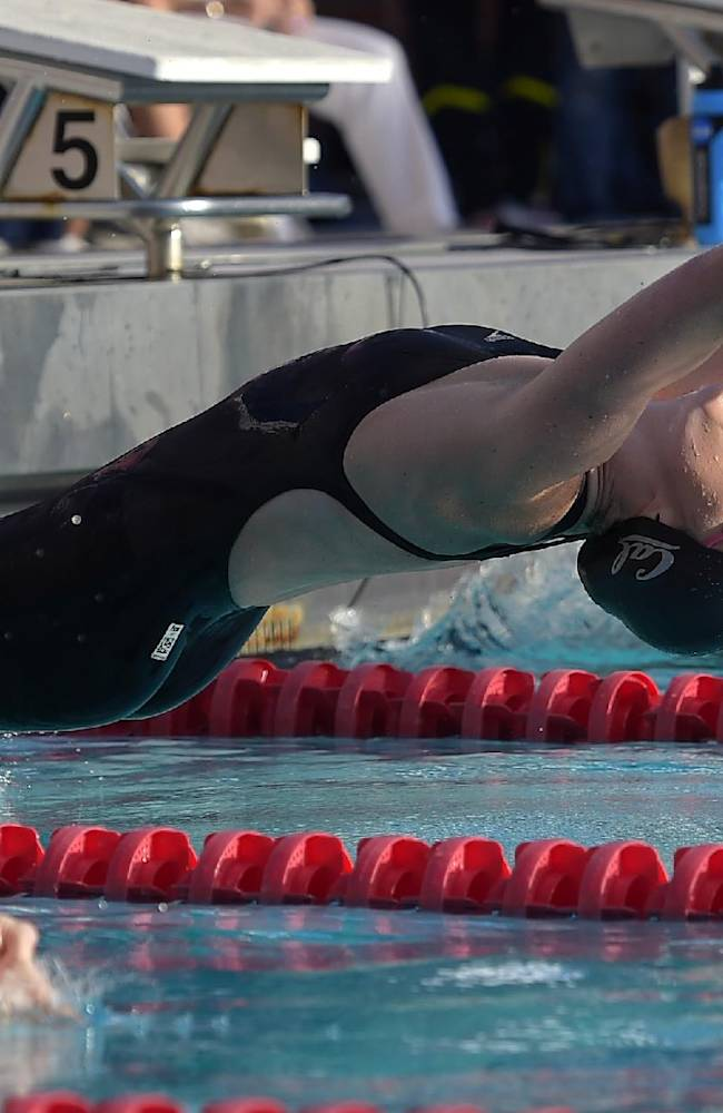 Missy Franklin, center, starts the women's 200-meter backstroke final alongside Kendyl Stewart, left, at the Los Angeles Invitational swimming meet at the University of Southern California, Friday, July 18, 2014, in Los Angeles. Franklin won with a time of 2 minutes, 10.21 seconds