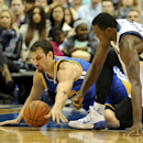 Golden State Warriors center Andrew Bogut, left, and Dallas Mavericks center Samuel Dalembert go after a loose ball in the first half during an NBA basketball game on Wednesday, Nov. 27, 2013, in Dallas The Associated Press
