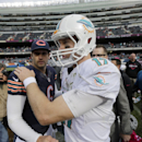 Miami Dolphins quarterback Ryan Tannehill (17) talks to Chicago Bears quarterback Jay Cutler (6) after their NFL football game Sunday, Oct. 19, 2014 in Chicago. The Dolphins won 27-14 The Associated Press