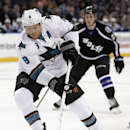 San Jose Sharks center Joe Pavelski (8) cuts around Tampa Bay Lightning left wing Jonathan Drouin (27) as he heads to the goal during the first period of an NHL hockey game Thursday, Nov. 13, 2014, in Tampa, Fla The Associated Press