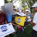 Australia's Adam Scott signs autographs during a practice round for the 2013 PGA Championship golf tournament at Oak Hill Country Club in Rochester, New York, August 5, 2013. REUTERS/Jeff Haynes