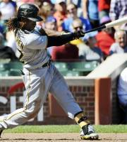Pittsburgh Pirates' Andrew McCutchen hits a home run against the Chicago Cubs during the third inning of a baseball game, Saturday, Sept. 15, 2012, in Chicago. (AP Photo/David Banks)