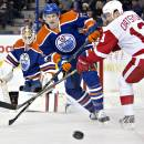 FILE - In this Jan. 6, 2015, file photo, Detroit Red Wings' Pavel Datsyuk (13) and Edmonton Oilers Jeff Petry (2), center, battle for the puck during first period NHL hockey action in Edmonton, Alberta. The Montreal Canadiens have made the first major move on the morning of the NHL's trade deadline day, Monday, March 2, 2015, by acquiring Jeff Petry from the Edmonton Oilers for draft picks. (AP Photo/The Canadian Press, Jason Franson, File)
