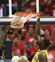 Indiana Pacers guard Lance Stephenson (1) scores against the Atlanta Hawks in the second half of Game 6 of a first-round NBA basketball playoff series in Atlanta, Thursday, May 1, 2014. Indiana won 95-88. (AP Photo/John Bazemore)
