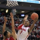 Ohio State's Deshaun Thomas, right, shoots over Wisconsin's Ryan Evans during the second half of an NCAA college basketball game Tuesday, Jan. 29, 2013, in Columbus, Ohio. Ohio State defeated Wisconsin 58-49. (AP Photo/Jay LaPrete)