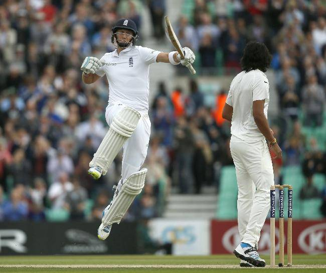 England's Joe Root celebrates scoring 100 runs not out during the third day of the fifth test cricket match against India at Oval cricket ground in London, Sunday, Aug. 17, 2014