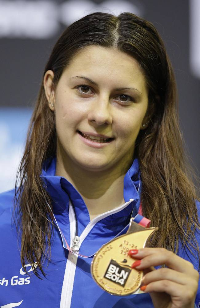 Britain's Aimee Willmott sports her bronze medal during the ceremony for the women's 400m medley at the LEN Swimming European Championships in Berlin, Germany, Monday, Aug. 18, 2014