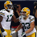Green Bay Packers wide receiver Jeff Janis, right, is congratulated by teammate Davante Adams after scoring on a 34-yard touchdown pass during the third quarter of an NFL preseason football game against the St. Louis Rams, Saturday, Aug. 16, 2014, in St.