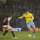 Crystal Palace's Martin Kelly, right, and Burnley's Scott Arfield battle for the ball in heavy rain during the English Premier League match at Turf Moor, Burnley, England, Saturday, Jan. 17, 2015