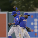 New York Mets' Curtis Granderson, left, and Eric Young Jr. celebrate their team's 7-6 win against the Los Angeles Angels after the 13th inning of a baseball game on Saturday, April 12, 2014, in Anaheim, Calif The Associated Press