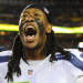 Seattle Seahawks defensive end Bruce Irvin celebrates his team's victory on the sidelines after an NFL wild card playoff football game against the Washington Redskins in Landover, Md., Sunday, Jan. 6, 2013. The Seahawks defeated the Redskins 24-14