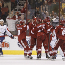 Phoenix Coyotes' Lauri Korpikoski (28) celebrates with teammates Oliver Ekman-Larsson (23), of Sweden, David Moss, left center, Antione Vermette, right center and David Schlemko, right, after his goal against the Washington Capitals during the third perio
