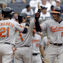 Baltimore Orioles' Adam Jones, right, celebrates his three-run home run with teammates Nick Markakis, left, and Brian Roberts during the seventh inning of a baseball game against the New York Yankees at Yankee Stadium, Sunday, Sept. 1, 2013, in New York. (AP Photo/Seth Wenig)