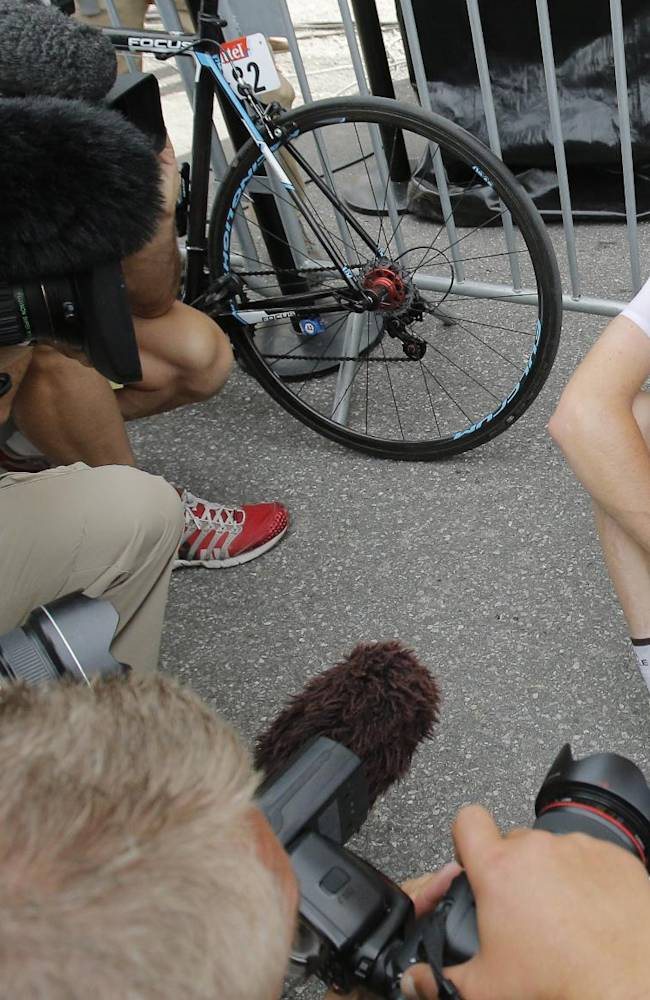 Best young rider Romain Bardet of France catches his breath after the fourteenth stage of the Tour de France cycling race over 177 kilometers (110 miles) with start in Grenoble and finish in Risoul, France, Saturday, July 19, 2014