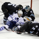 Toronto Maple Leafs' James van Riemsdyk (21) collides with San Jose Sharks left wing James Sheppard, top left, goalie Antti Niemi, center, and defenseman Brent Burns (88) during the second period of an NHL hockey game Thursday, Jan. 15, 2015, in San Jose,