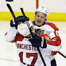 Florida Panthers' Tomas Kopecky, right, of Slovakia, and Jesse Winchester celebrate a goal by Kopecky in the third period of an NHL hockey game against the Minnesota Wild, Friday, Nov. 15, 2013, in St. Paul, Minn. The Wild won 3-2. AP Photo/Jim Mone) The