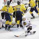 Chicago Blackhawks right wing Ben Smith (28) celebrates after scoring against the Nashville Predators in the first period of an NHL hockey game Thursday, Oct. 23, 2014, in Nashville, Tenn. (AP Photo/Mark Humphrey)