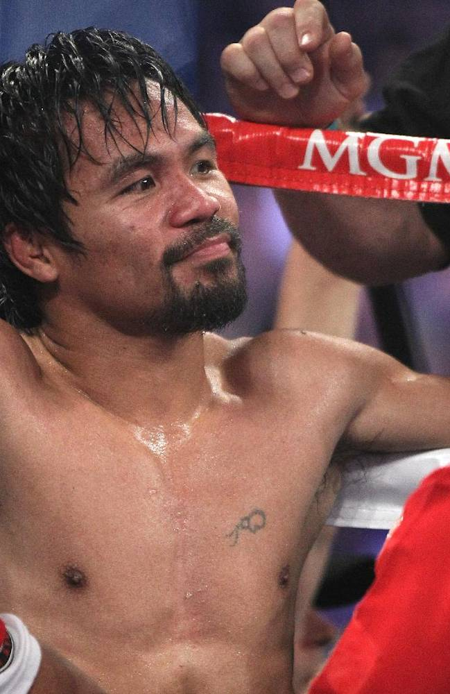 Manny Pacquiao, of the Philippines, sits in his corner between rounds of his WBO welterweight title boxing fight against Timothy Bradley Saturday, April 12, 2014, in Las Vegas