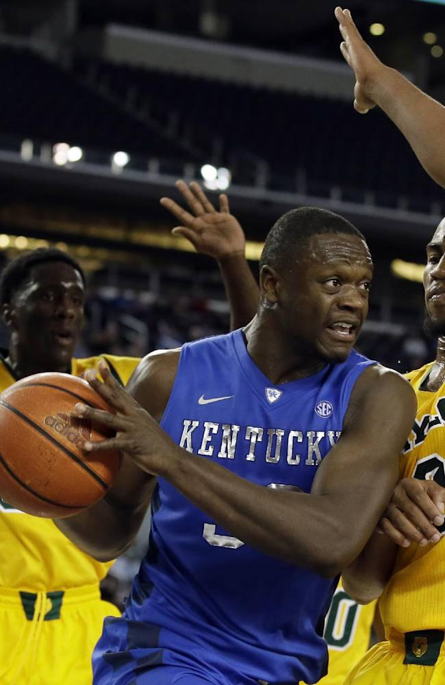 Baylor's Taurean Prince, rear, and Rico Gathers, right, deny Kentucky forward Julius Randle, center, a shot opportunity in the second half of an NCAA college basketball game, Saturday, Dec. 7, 2013, in Arlington, Texas. Baylor upset Kentucky 67-62