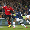 Manchester United s Patrice Evra, center, and Marouane Fellaini, right, compete for the ball with Cardiff City s Kevin Theophile-Catherine during their English Premier League soccer match at Cardiff City Stadium in Cardiff, Wales, Sunday, Nov. 24, 2013
