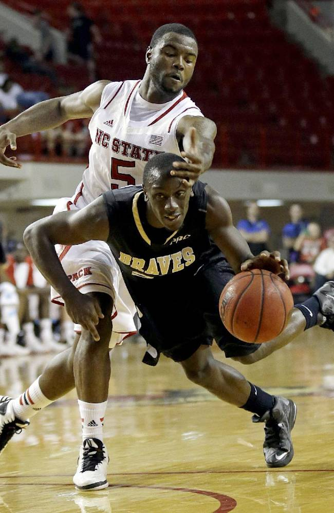 North Carolina State's Desmond Lee (5) defends against UNC Pembroke's Quamain Rose during the second half of an exhibition NCAA college basketball game in Raleigh, N.C., Wednesday, Oct. 30, 2013. North Carolina State won 96-85