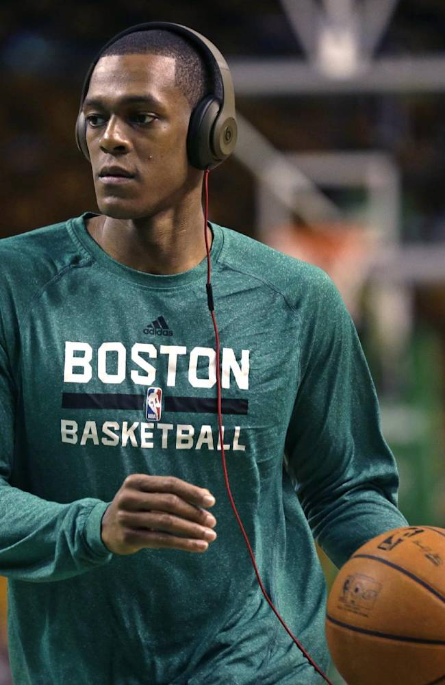 Boston Celtics guard Rajon Rondo wears headphones as he works out during a practice before an NBA basketball game against the Los Angeles Lakers, in Boston, Friday, Jan. 17, 2014. Celtics head coach Brad Stevens and general manager Danny Ainge both said Rondo would return for the game