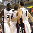 Gonzaga's Sam Dower, left, celebrates with David Stockton (11) and Kevin Pangos (4) after Stocktons opeing point against Washington State in the first half of an NCAA college basketball game, Thursday, Nov. 21, 2013, in Spokane, Wash. (AP Photo/Jed Conklin)
