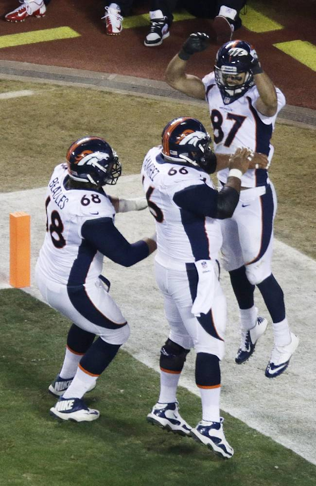 Denver Broncos wide receiver Eric Decker (87) celebrates a touchdown with center Manny Ramirez (66) and guard Zane Beadles (68) during the second half of an NFL football game, Sunday, Dec. 1, 2013, in Kansas City, Mo