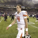 Oregon State quarterback Sean Mannion leaves the field as Washington fans rush in from the stands after Washington upset Oregon State, 20-17, in an NCAA college football game, Saturday, Oct. 27, 2012, in Seattle. (AP Photo/Ted S. Warren)
