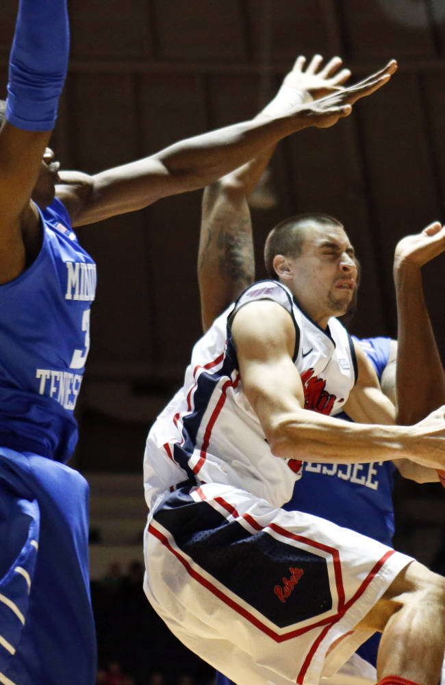 Mississippi guard Marshall Henderson, second from left, ducks under the defense of Middle Tennessee State forward Joshua Phillips (3) in the first half of an NCAA college basketball game in Oxford, Miss., Saturday, Dec. 14, 2013