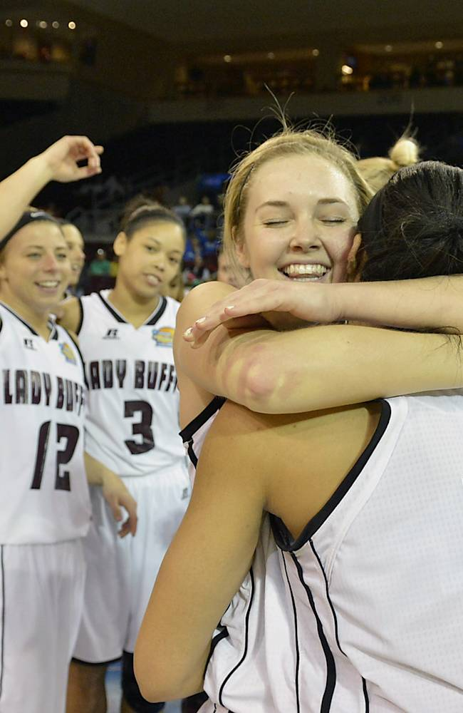 West Texas A&M's basketball player Casey Land, front left, and her teammate Devin Griffin celebrate with their team after an 80-66 victory over Nova Southeastern in an NCAA women's Division II basketball tournament semifinal in Erie, Pa., on Wednesday, March 26, 2014
