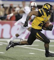 Missouri running back Henry Josey (20) goes in for a touchdown against Oklahoma State during the second half of the Cotton Bowl NCAA college football game, Friday, Jan. 3, 2014, in Arlington, Texas. (AP Photo/Brandon Wade)