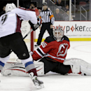 New Jersey Devils goalie Cory Schneider blocks a shot by Colorado Avalanche center Matt Duchene during the first period of an NHL hockey game, Saturday, Nov. 15, 2014, in Newark, N.J The Associated Press