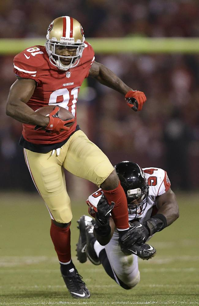 San Francisco 49ers wide receiver Anquan Boldin (81) runs past Atlanta Falcons outside linebacker Stephen Nicholas (54) during the second half of an NFL football game in San Francisco, Monday, Dec. 23, 2013
