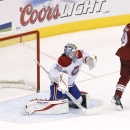 Phoenix Coyotes' Shane Doan (19) redirects the puck past Montreal Canadiens' Peter Budaj (30), of the Czech Republic, for a goal during the third period of an NHL hockey game Thursday, March 6, 2014, in Glendale, Ariz. The Coyotes defeated the Canadiens