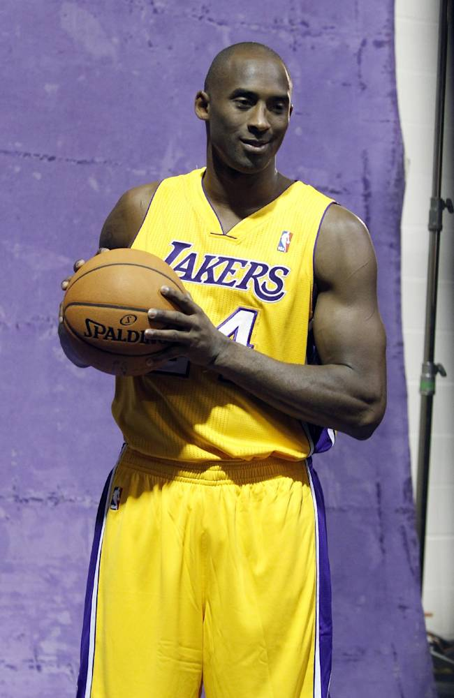 Los Angeles Lakers guard Kobe Bryant stands in a photo booth during the NBA basketball team's media day Saturday, Sept. 28, 2013, in El Segundo, Calif