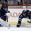 Winnipeg Jets' goaltender Ondrej Pavelec (31) watches and Mark Stuart (5) and St. Louis Blues' Vladimir Sobotka (17) battle for the puck during second period NHL hockey action in Winnipeg, Tuesday, Dec. 10, 2013 The Associated Press