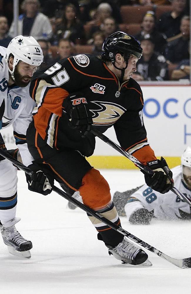 Anaheim Ducks' Matt Beleskey (39) shoots and scores as San Jose Sharks' Joe Thornton (19) and Brent Burns (88) watch during the second period of an NHL hockey game Wednesday, April 9, 2014, in Anaheim, Calif