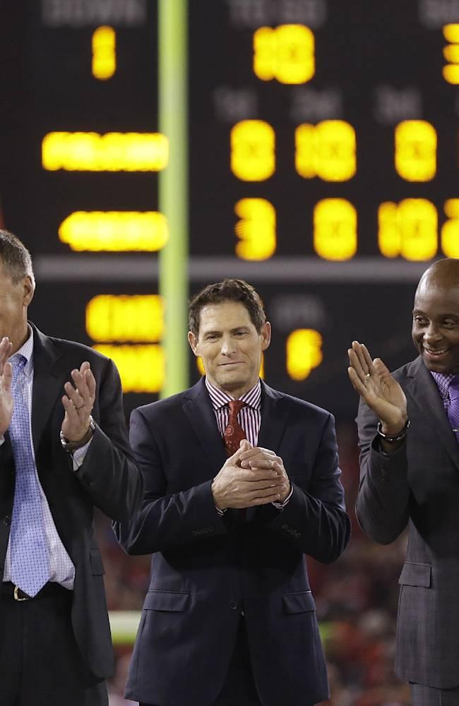 Former San Francisco 49ers players Dwight Clark, from left, Steve Young and Jerry Rice stand on stage at Candlestick Park after an NFL football game between the San Francisco 49ers and the Atlanta Falcons in San Francisco, Monday, Dec. 23, 2013. The 49ers played their last regular season game at Candlestick before moving a new stadium for the 2014 season