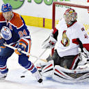 Ottawa Senators goalie Craig Anderson (41) makes the save as Edmonton Oilers' Ryan Smyth (94) looks for the rebound during third period NHL hockey action in Edmonton, Alberta, on Tuesday March 4, 2014 The Associated Press