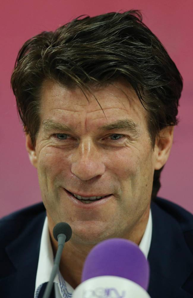 In this Wednesday, July 2, 2014 photo, Danish soccer coach Michael Laudrup speaks during a press conference after he was announced head coach of the Qatar soccer club Lekhwiya SC, in Doha, Qatar. (AP Photo)