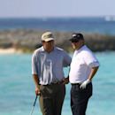 Raymond Floyd, right, and his son, Robert, talk on the 17th fairway Sunday Dec. 2, 2001 during the Office Depot Father/Son Challenge at the Ocean Club Golf Course on Paradise Island in the Bahamas. The Floyds finished with 20 under par 61 giving them first place overall and a prize of $200,000. (AP Photo/Tim Aylen)