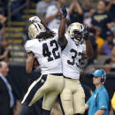 New Orleans Saints defensive back Pierre Warren (42) celebrates his interception with cornerback Stanley Jean-Baptiste (33) in the first half of an NFL preseason football game against the Baltimore Ravens in New Orleans, Thursday, Aug. 28, 2014. (AP Photo/Rogelio Solis)