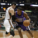 Sacramento Kings' Jason Thompson, right, looks to get around Milwaukee Bucks' Ersan Ilyasova during the first half of an NBA basketball game Wednesday, March 5, 2014, in Milwaukee The Associated Press